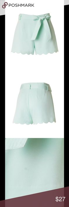 """SALEMINT BELTED SCALLOP HEM SHORTS Mint Shorts featuring a pretty Scalloped hem. Ties in the front with a side zipper. The pictures don't do these justice! Sizes S, M, L. Polyester. No trades. Small: 28"""" Waist, 2"""" Inseam, 11"""" Rise, & 12 1/2"""" Length. Medium: 29 1/2"""" Waist, 2 1/4"""" Inseam, 11"""" Rise, & 13 1/4"""" Length. Large: 31"""" Waist, 2 1/2"""" Inseam, 11"""" Rise, & 13 1/4"""" Length. Price is firm. SOUTHERN CHARM BOUTIQUE Shorts"""