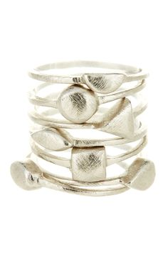"""Multi-Shape Ring Stack by Marcia Moran $173 - $80 @HauteLook. - Rhodium plated assorted shape ring stack - Set of 7 - Approx. 1"""" stacked width - Materials: Rhodium plated brass. Fashion jewelry cleaner only."""