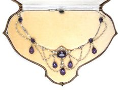"""A wonderful amethyst, diamond and natural pearl necklace in its original leather case. It is platinum with 15ct gold mounts on the amethyst sections. It was made at the height of the """"Belle Epoque"""", circa 1910."""