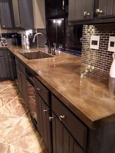 39 Cool Minimalist Concrete Kitchen Countertop Ideas With Wooden Storage And Modern Washbasin Image