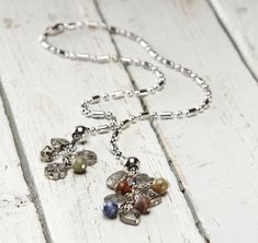 Tutorial on how to make your own ball chain lariat necklace with danglers on CraftsUnleashed.com