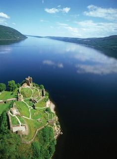 'This photograph is only a hint of Loch Ness' vastness. If there is a monster lurking in its depths, you can understand how it has managed to stay hidden. Urquhart Castle (pictured), one of Scotland's largest strongholds, commands magnificent views over the huge expanse of water.'