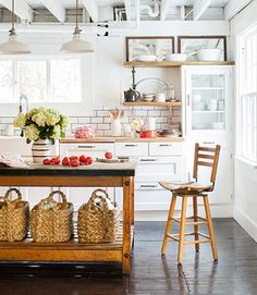So much to love: Open shelving, the contrast of the dark floor against the white cabinets, open island. If I can't have a 2nd sink in the island, I'd want this.