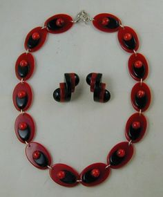 Leave Necklace and Snail Earrings. By Jorge Caicedo Montes de Oca . Hand Crafted using authentic vintage Bakelite and sterling silver . Red and Black combination .
