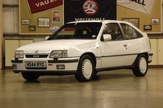 1990: Vauxhall Astra MK2 GTE 16V. My first company car. So fast. Shame it got stolen and ended up in a canal :(