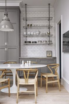 Open shelving for wet bar in gray kitchen with sleek kitchen table modern light wood minimalism