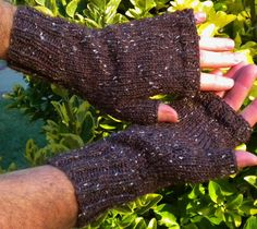 Mens fingerless gloves are handknit in cordovan brown 55% merino wool, 25% superfine alpaca and 20% Donegal tweed yarn. These brown mens fingerless gloves are knit with ribbing at the wrist and knuckles for a close, warm fit, and smooth stockinette stitch throughout the rest of the glove for a classic, tailored look. The fabric is exceptionally soft, due to the combination of both merino wool and alpaca. The Donegal tweed adds flecks of color to the deep cordovan brown, lending to the…