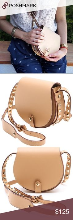 Rebecca Minkoff Mini Skylar Leather Crossbody Like new, mini skylar leather crossbody in a beautiful light camel hue. Rare color and goes with EVERYTHING! First pic is of the actual bag. Never wore it except for picture taking on fashion blog so it's in great condition. Pyramid studs line the strap and edge of bag with button magnetic closure. Selling bc I never wear it. No trades. Rebecca Minkoff Bags Crossbody Bags