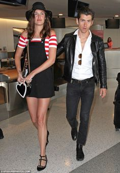 Close to you: Alex Turner couldn't keep his hands off of his model girlfriend Taylor Bagle...