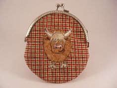 http://www.etsy.com/listing/119605950/highland-cow-coin-purse