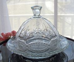 "EAPG ANTIQUE GLASS BUTTER DISH with COVER / LID / DOME . THISTLEBLOW PATTERN  7-1/4"" diameter measured across the bottom plate x 5-1/2"" tall to the tip of the finial!  The inner ring of the plate (butter seating area) is 5"" diameter.   Jenkins Glass Co; Greentown, IN  c. 1900  SOLD $51.00"