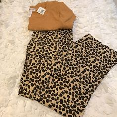 Leopard Lounge pants. Free T Shirt w/ Purchase NWT Leopard Lounge Pants. Size: Small. Color is tan with brown & black leopard spots. Pull on elastic self tie waist. 100% cotton. Machine wash. Lay flat to dry. Free NWT mustard color short sleeve t shirt Size: M throwing in with it. NO TRADES. FINAL PRICE Emme jordan  Intimates & Sleepwear Pajamas