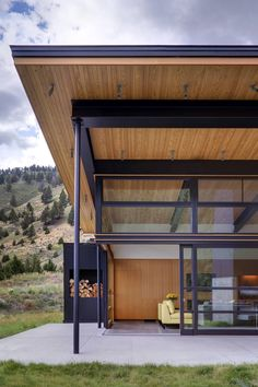 River Bank House. Wow. Gorgeous. All glass and wood. I love that yellow couch. And the landscaping.