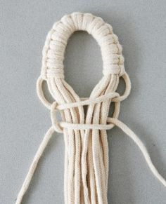 Look: how they make a loop to hang your macrame project.