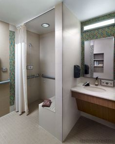 Each patient room has a large adjacent toilet room with shower.The glass mosaic accents vary in color palette for each Unit.