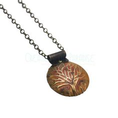 Tree of Life Sunset Necklace | $65 This pendant shares the beauty of a sunset with the fine detail of a full branched tree.