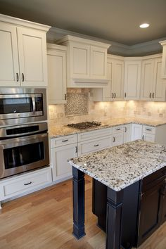 Granite Island Countertop In Farm Style Kitchen By Lawrence Homes, Inc |  Photography By One