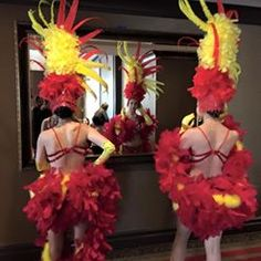 Las Vegas Showgirls a Primping! Bright yellow & red Showgirls of Premier Showgirls.