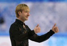 ソチ冬季五輪、フィギュアスケート団体戦、男子シングル・フリースケーティング(FS)。歓声に応えるエフゲニー・プルシェンコ(Yevgeny Plushenko、2014年2月9日撮影)。(c)AFP=時事/AFPBB News