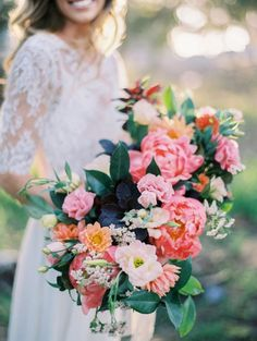 Gorgeous + colorful oval shaped spring bouquet via Natalie Bray