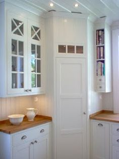 Corner pantry in White, scandinavian kitchen. I love the narrow shelves for book. Corner pantry in Corner Pantry Cabinet, Corner Kitchen Pantry, Kitchen Ikea, Kitchen Pantry Design, Kitchen Pantry Cabinets, Cabinet Storage, Cabinet Ideas, Kitchen Decor, Cabinet Closet
