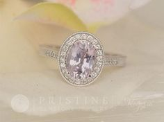 Vintage Style Sapphire Engagement Ring Featuring Lavender Sapphire Center Stone Main Stone weight: 1.94 cts size: 8.6 x 6.2 mm oval color: a combination of soft pink and purple clarity: very good, eye