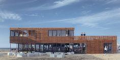 Strandpaviljoen The Hague Beach Stadium is een project uit 2016. Op deze plek is een sportpaviljoen inclusief fitnessschool, yoga studio en groepsfaciliteiten ontworpen. Het paviljoen is zoals de meeste strandtenten een tijdelijk en demontabel gebouw. In het najaar wordt het gebouw weer gedemonteerd en opgeslagen. De houten gevel geeft het paviljoen een warme uitstraling en zorgt voor een spel tussen open en dicht.
