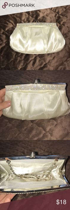 David's Bridal clutch purse White satin David's bridal clutch purse with rhinestone accents. Both chain and cord strap, one small separate pocket inside, used once for prom, perfect condition. David's Bridal Bags Clutches & Wristlets