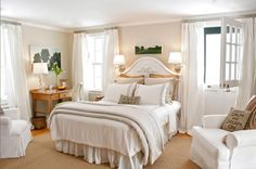 bedroom makeover by Stephen Saint-Onge - white linens, dutch door, rustic desk, artwook