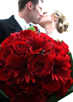 red roses and red gerber daisies wedding flower bouquet, bridal bouquet, wedding flowers, add pic source on comment and we will update it. www.myfloweraffair.com can create this beautiful wedding flower look.