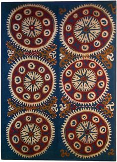 Deghestan Cotton Kaitag from the Caucasus region, with embroidered silk; red and white circular motifs on a blue ground.  | ca. late 19th century