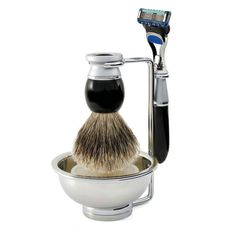 Riva Ebony, Mach3 Shaving Set:  This exquisite four piece Riva shaving set comprises imitation ebony & satin chrome razor fitted with the Gillette Mach3 blade system for a close and safe shave. Silver Tip shaving brush and chrome plated double wire stand with bowl.
