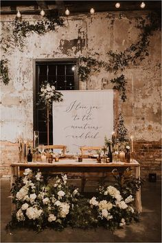 The bride and groom decided on this incredible sweetheart table. The table was surrounded by candles and the most amazing white flowers and greenery. #sweethearttable #reception Reception Table, Wedding Reception Decorations, Wedding Table, Fall Wedding, Our Wedding, Dream Wedding, Reception Ideas, Wedding Dreams, Bride Groom Table