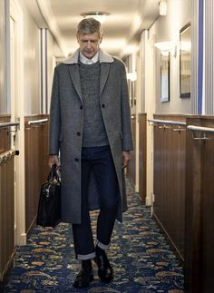 Boss Arsene Wenger is wearing a shirt, a sweater and Lanvin coat, jeans ...