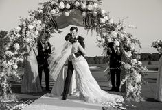 perfect moment captured by Craig Paulson Photography  Arch Design by Crest Florist, East Hanover, NJ  Venue - Trump National Golf Course, Bedminster, NJ