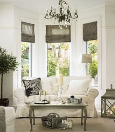 Bay Windows with loveseat and shades {Perfect for mom's living room!}