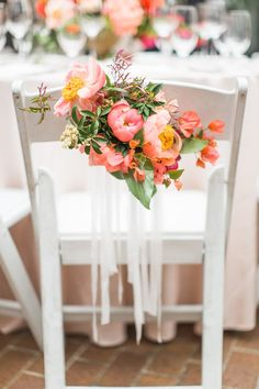 chair decorated with coral charm peonies - photo by nbarrett photography http://ruffledblog.com/texas-garden-wedding-at-dallas-arboretum