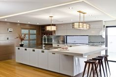 Wonderful Contemporary Kitchen in Australia: Contemporary Emw Kitchen With L Shape Island With White And Stainless Steel Countertop With Sink And Wooden Stools ~ SFXit Design Kitchen Inspiration