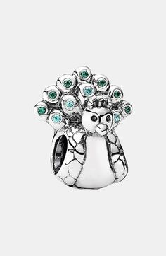 Free shipping and returns on PANDORA Peacock Charm at Nordstrom.com. Blue and green plumage brightens a tiny peacock carved from gleaming sterling silver to symbolize renewal.