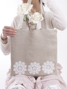 The outer fabric is 100% linen. The three white lace flowers on the front of the bag are vintage antique lace. The lace on this bag has been stitched on by hand ! Incredible! There are no messy machine stitches to obscure the quality of the piece. Every detail of the lace is secured with INVISIBLE hand stitching, it took may long hours to achieve this quality of finish. Back of the bag is the same linen as rest of bag.    I welcome commissions so if you would like a custom item made, please…