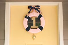 The cutest wreath for a pink nautical birthday party!