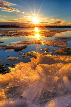 Winter Sunshine - The ice sheet breaks up into crystals as it melts in early spring - The St. Lawrence River, Massena, New York