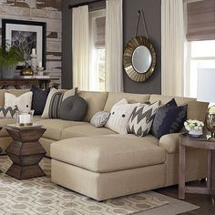 """Design Tip: Load your sofa up with mismatched pillows for a comfy inviting space. (Photo credit: http://www.bassettfurniture.com/U-Shaped-Sectional-…"""