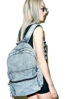 Daytripper Acid Wash Backpack is ready to keep up with all yer activities, day or night. This classic denim backpack has been throwback acid washed to perfection with a roomy interior for all yer trippy essentials, complete with front pocket, dual adjustable straps, and top zip around closure.