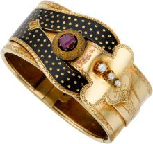 Victorian Ruby, Half-Pearl, Enamel, Gold Bracelet The hinged bangle features a cushion-shaped ruby, enhanced by half-pearls, accented by black enamel, applied on 18k yellow gold.