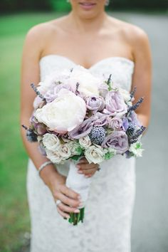 The bridal bouquet in smoky shades of lavender-blue.