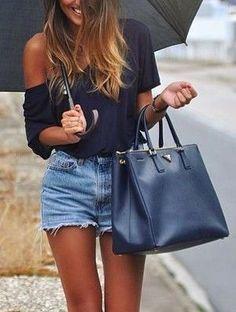 chic :) short denim with black tee and black umbrella. Black leather handbag. Fashion trends.