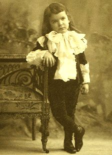 little lord fauntleroy suit: velvet jacket and knee pants with large lacey blouse and ruffled sleeves.