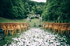petal aisle.  wood arbor.  Smoky Mountain wedding ceremony at the Barn at Chestnut Springs. Steve + Keisha {Rhino Media Productions}