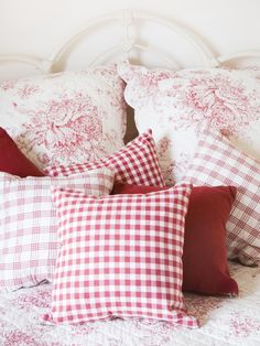 red and white pillows in coordinating fabrics. plaid & floral